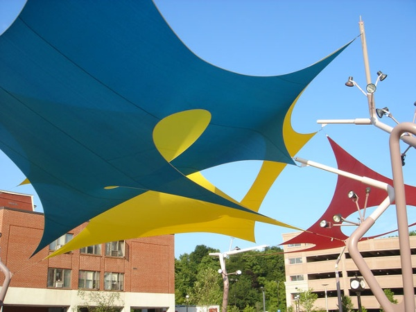 Duvall designed the three-layered fabric structures, freestanding 50-foot curvilinear poles and branched lighting system for this urban waterfront park in Auburn, ME. Design: Charles Duvall.