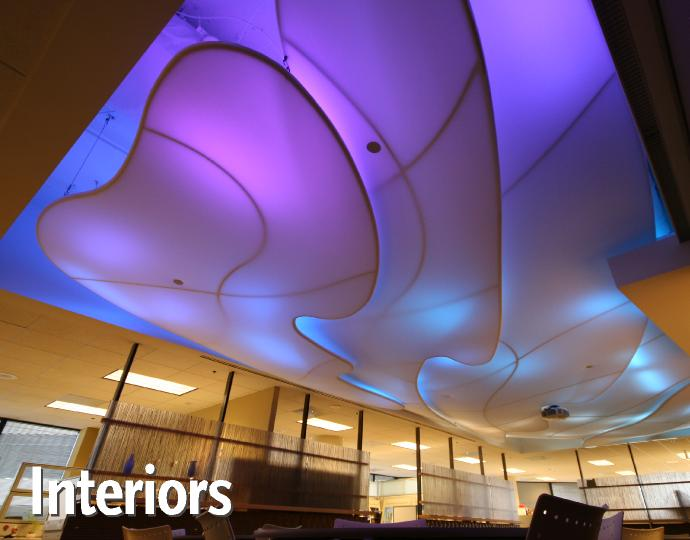 Color-changing backlit tension fabric Clouds are suspended over the employee lounge in Mulvanny G2 & Fabric Architecture | Transformit