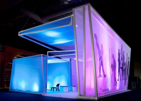 This Transformit exhibit consists of the Louise Room, the Ray Room, and the Julia Room with a giant Piet Wall and custom awning over the entire space. Internal lighting glows on the sheer fabric layers.